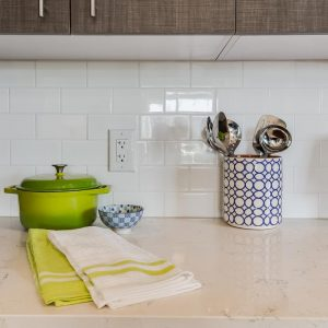 apartment condo suite quartz counter with subway tiled backsplash