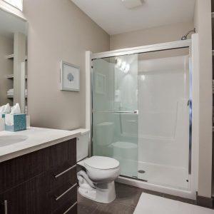 condominium master ensuite shower with towel storage