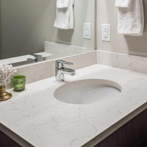 main bath vanity with quartz counter and undermount sink